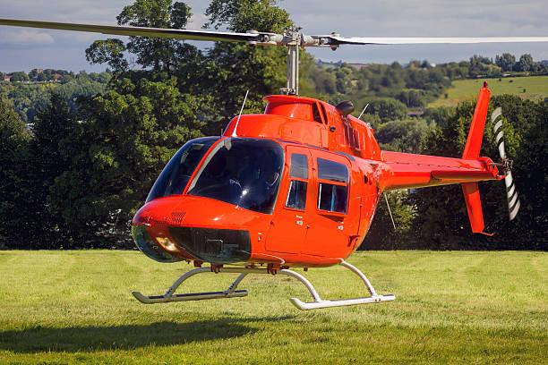 Red private helicopter landing / take off. stock photo