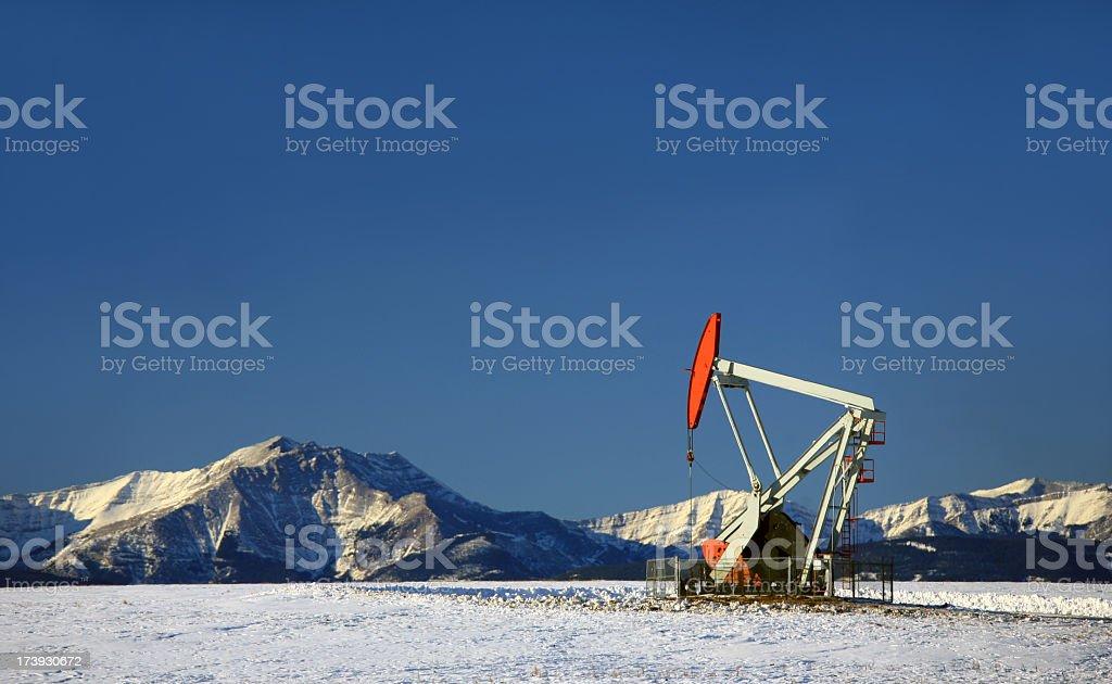 Red Pumpjack in Winter Alberta stock photo