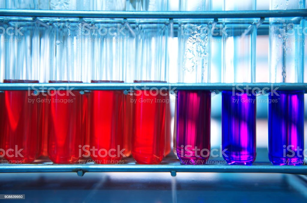 red purple glass test tube in metal rack in medical biochemistry science laboratory background stock photo