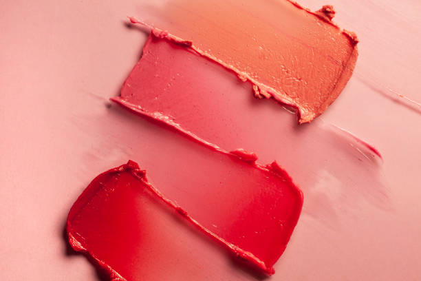 Red purple pink lipstick on terracotta pink background Smudged red purple pink textured tint or lipstick on multi-colored pink background blusher make up stock pictures, royalty-free photos & images