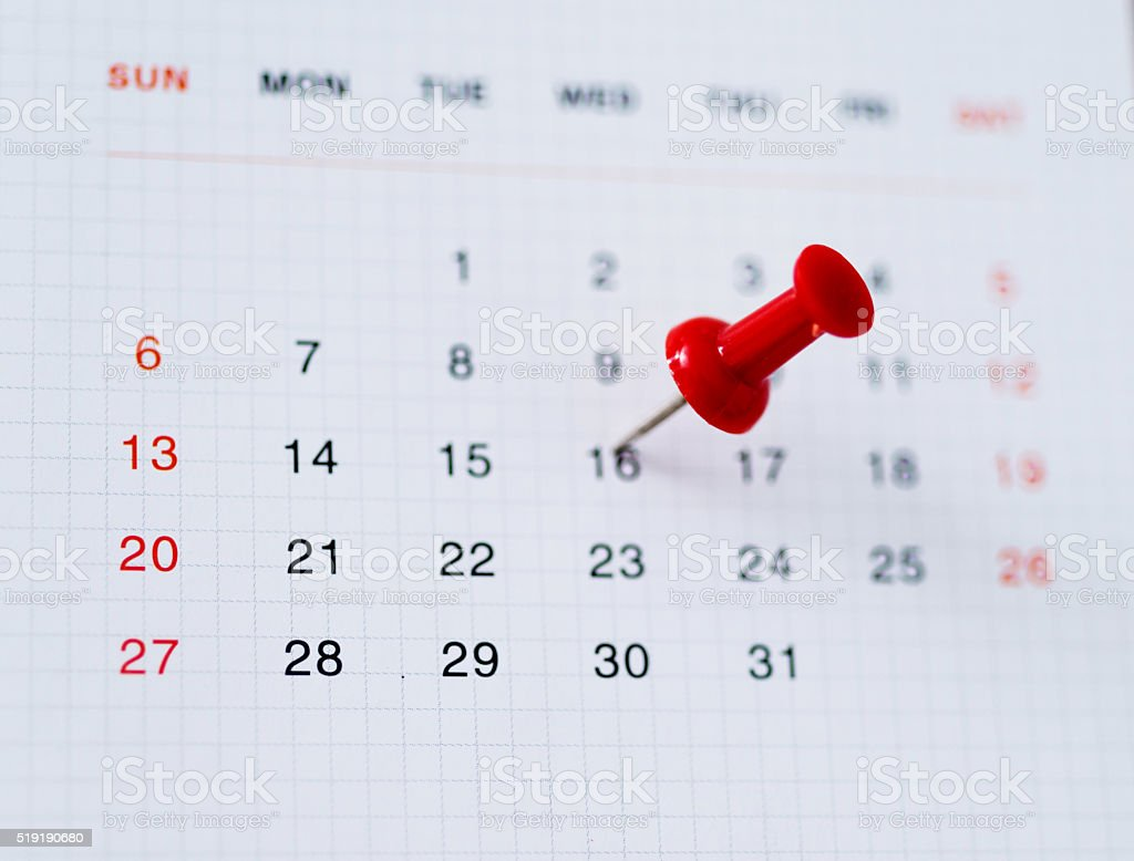 Red push pin in calendar stock photo