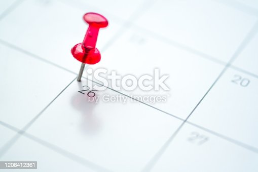 istock Red push pin on calendar 1206412361