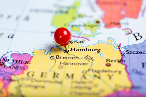 Red push pin on map of Germany