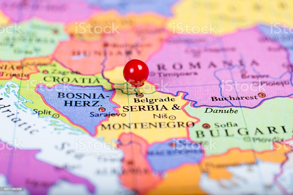 Red push pin on map of Serbia stock photo