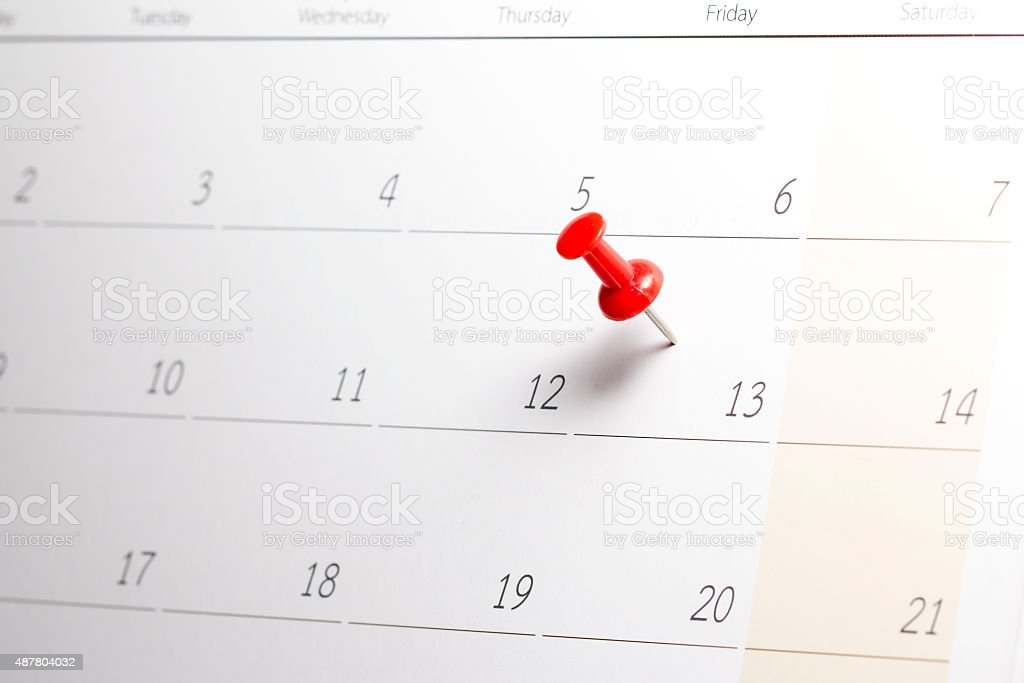 Red Pushpin on Friday 13th stock photo