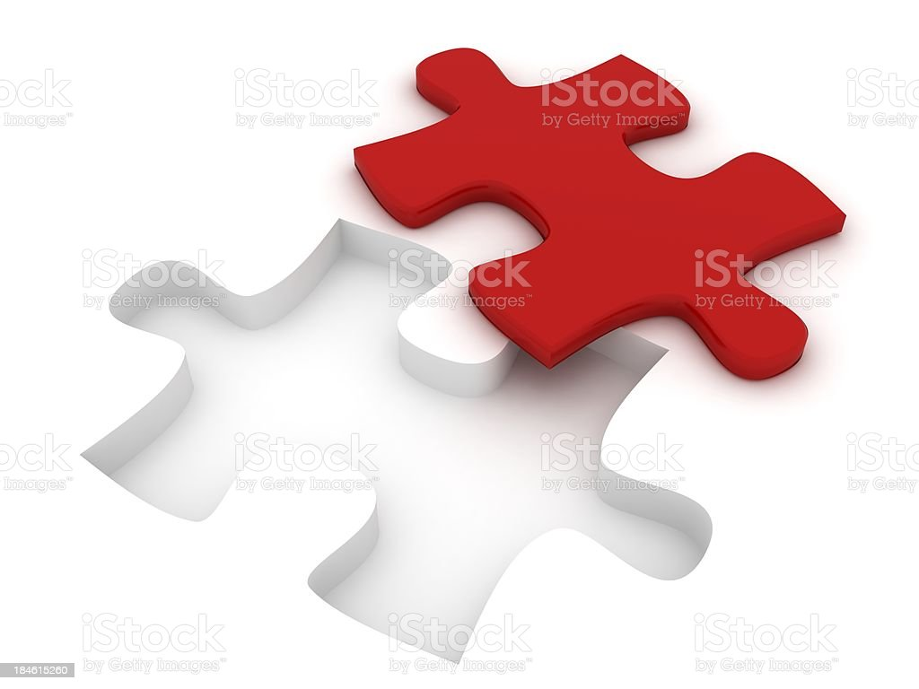 Red puzzle piece lying besides its white setting stock photo
