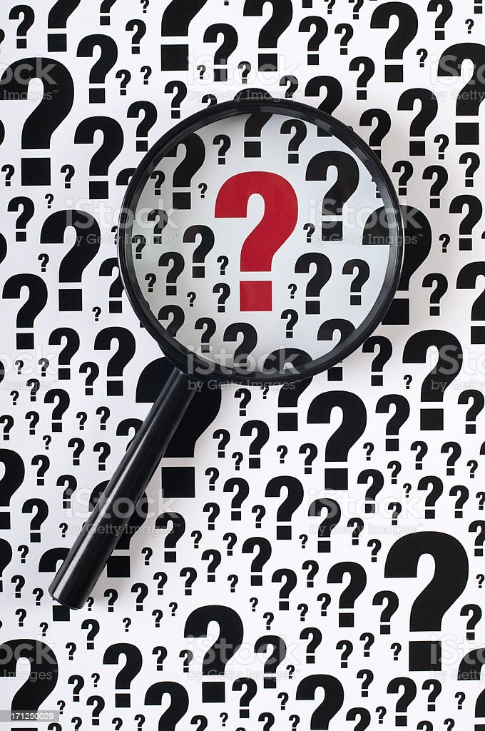 Red question mark in a sea of black and white royalty-free stock photo