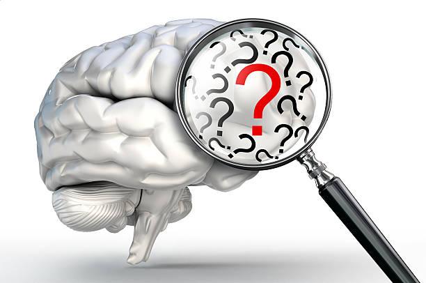 赤い疑問符が人間の脳と拡大鏡 ストックフォト