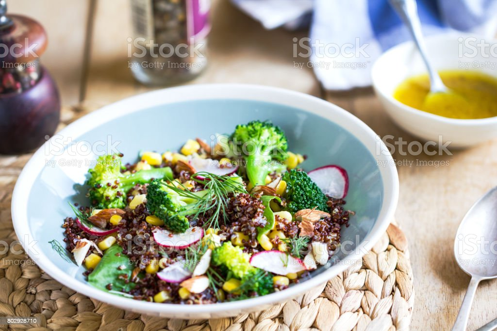 Red Quinoa with Sweet Corn and Broccoli salad by vinaigrette stock photo