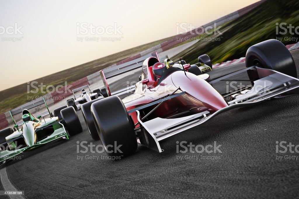 Red race car on a track leading the pack stock photo