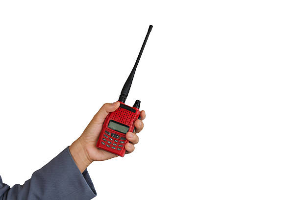 red radio communication on working women hand - ham radio stock photos and pictures