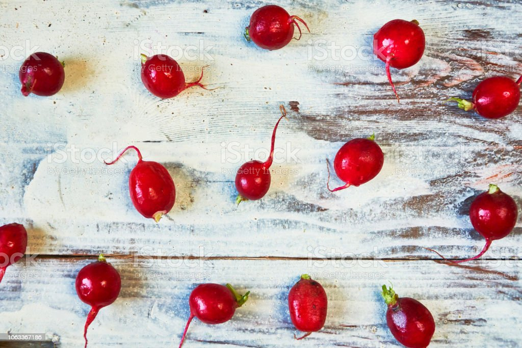 Red radish in white wooden bacground. Top view stock photo