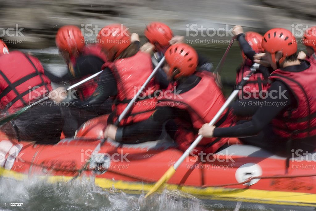 Red rafting team on whitewater royalty-free stock photo