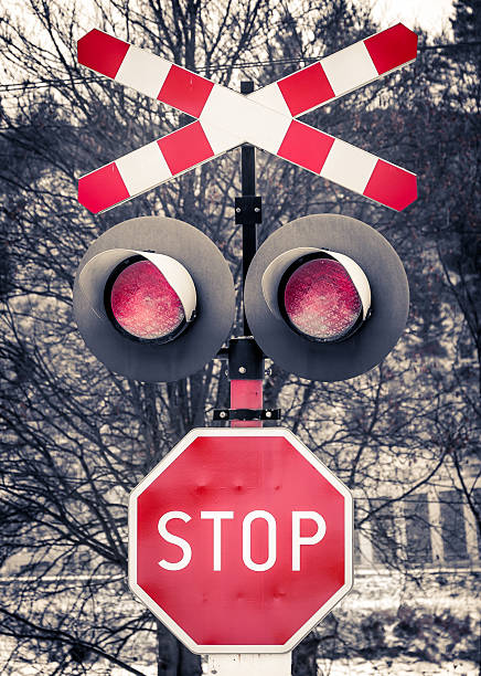 red railroad warning sign - railway signal stock photos and pictures