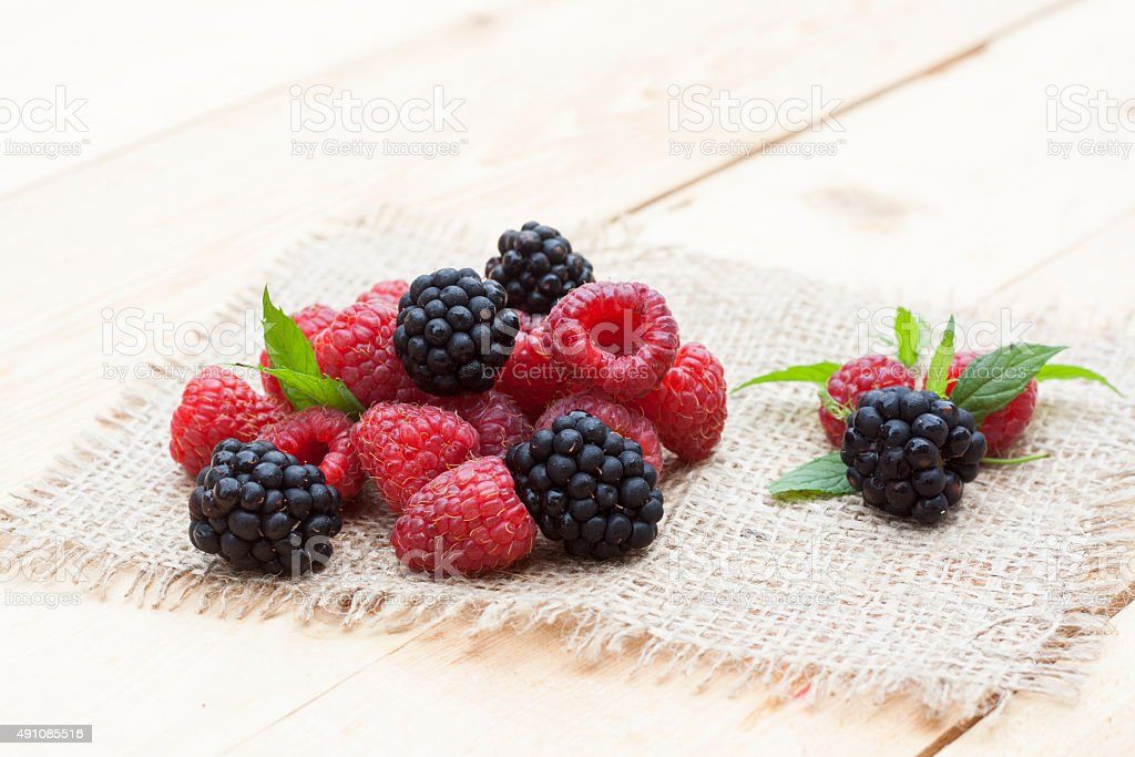 Red raspberry, blackberries and mint stock photo