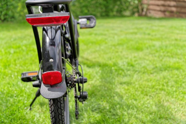 Red rear reflector on bicycle stock photo