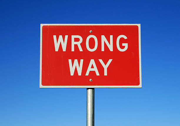Red rectangular wrong way sign on blue background stock photo