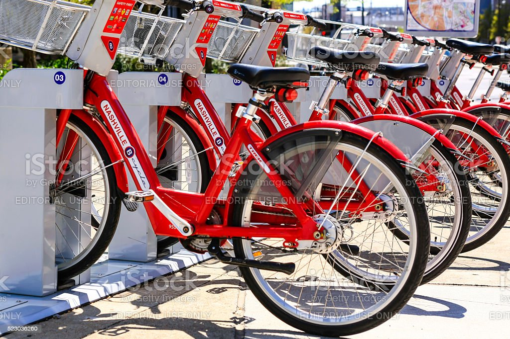 Red rental Bicycles in downtown Nashville, Tennessee Nashville, TN, USA - April 5, 2016: Red rental Bicycles in downtown Nashville, Tennessee Activity Stock Photo