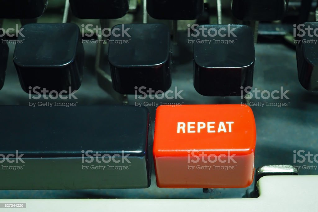 Red repeat button on typewriter. Do something again. stock photo