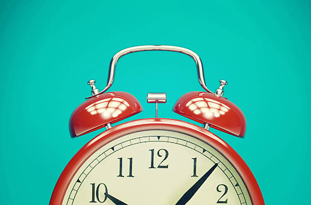 red retro alarm clock on blue background with vintage filter - alarm stock pictures, royalty-free photos & images