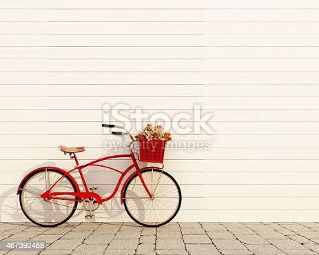 istock red retro bicycle with basket and flowers 467392488