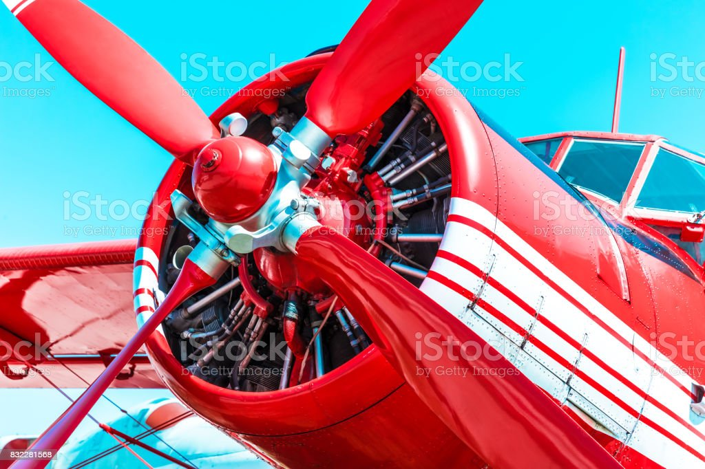Red retro propeller engine airplane stock photo