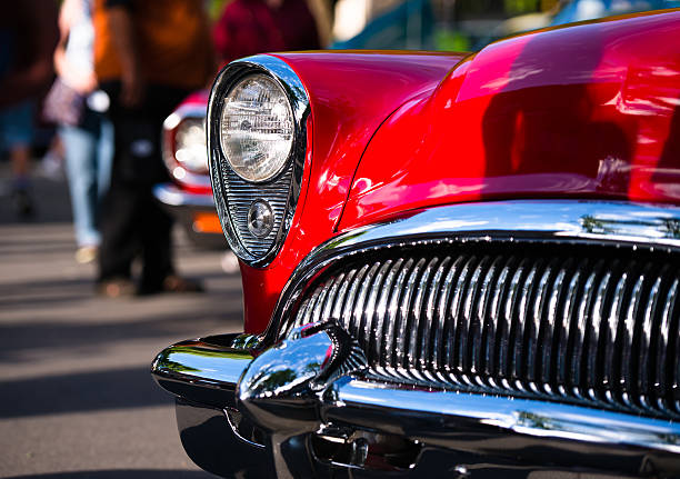 red retro vintage chrome car details - classic cars stock photos and pictures