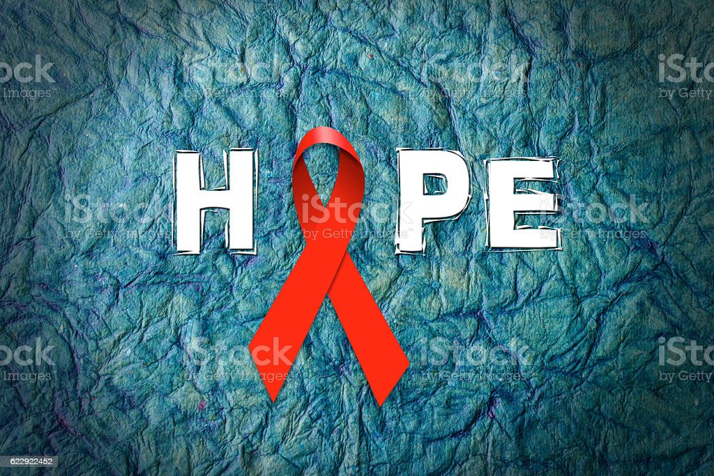 Red Ribbon- Aids and HIV on world AIDS day stock photo