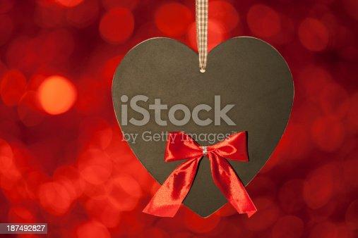 908708148 istock photo red ribbon blackboard heart 187492827