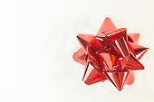 istock red ribbon bow on snow image background. 1064019706