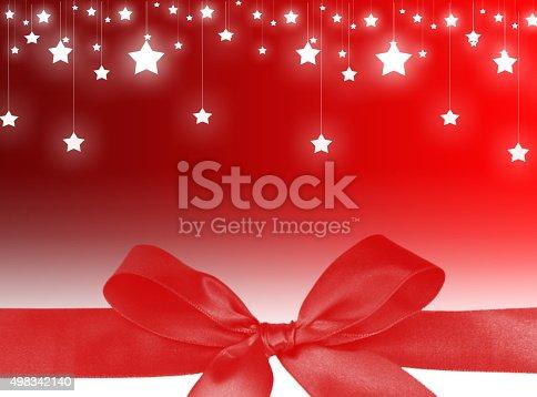 1020742072istockphoto Red ribbon Christmas background 498342140