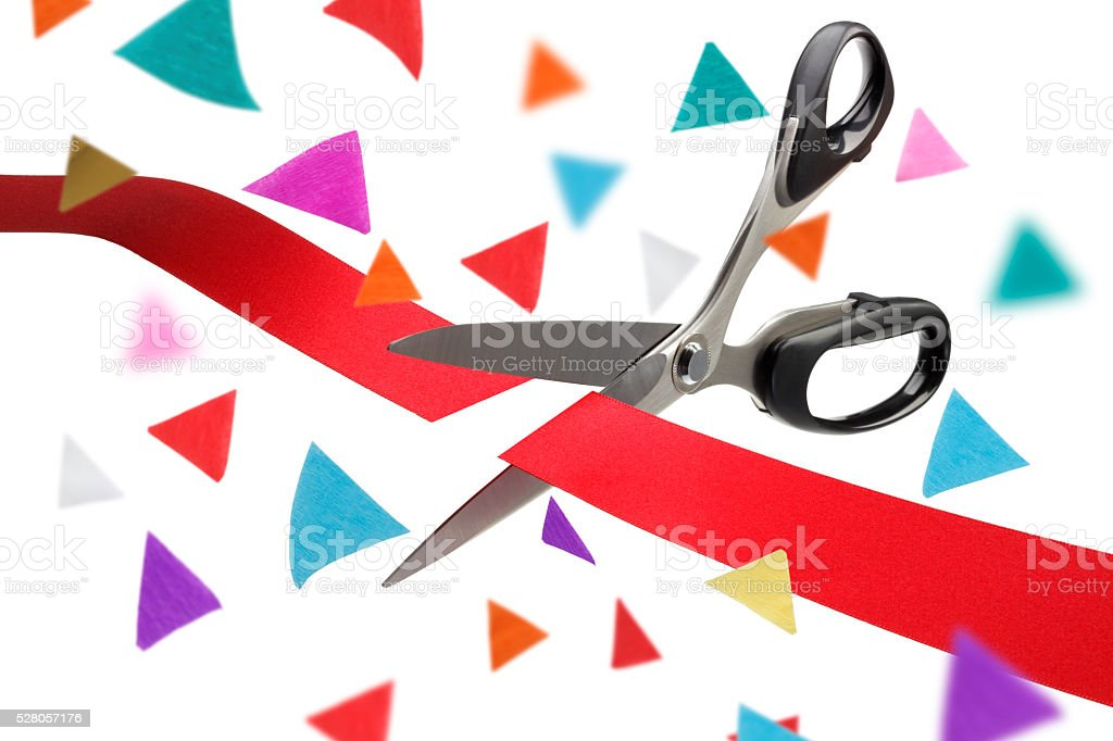 Red Ribbon Cutting Ceremony with Confetti stock photo