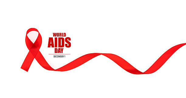 Red ribbon for World AIDS Day on white background stock photo