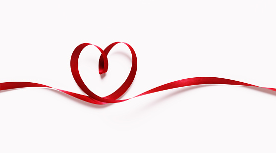 Red Ribbon Forming Heart Shape On White Background - Valentine's Day Concept