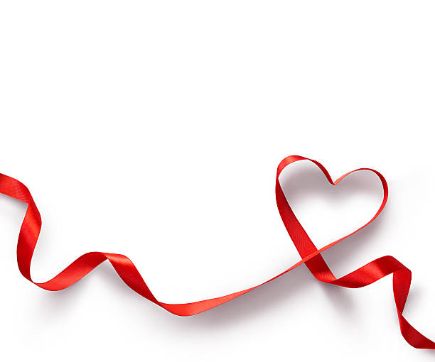 red ribbon heart on white background. - february stock photos and pictures