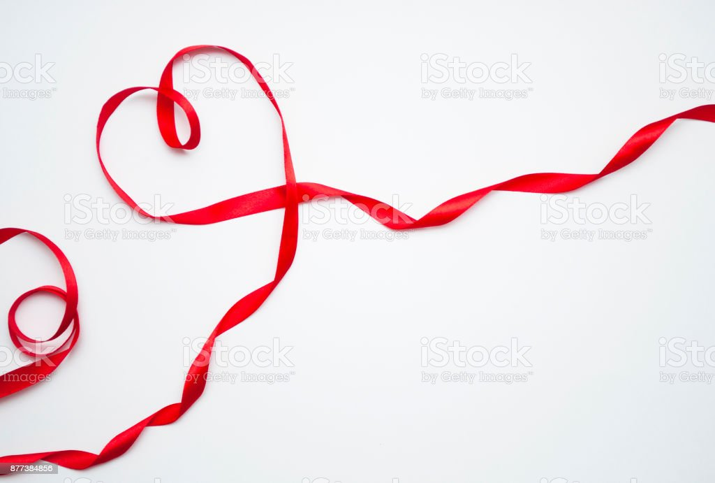 Red Ribbon Heart on white background stock photo