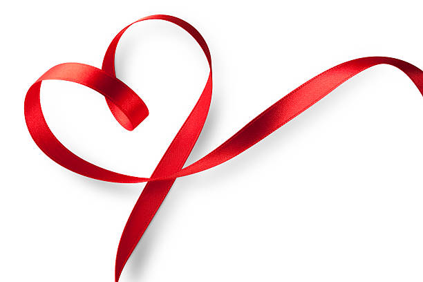 red ribbon in heart shape - conceptual symbol stock pictures, royalty-free photos & images