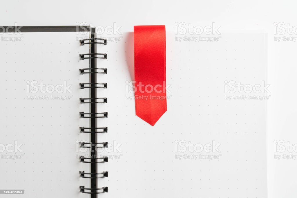 red ribbon on light book stock photo