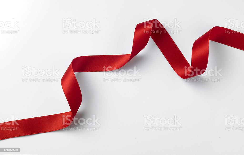 Red ribbon styled on white stock photo