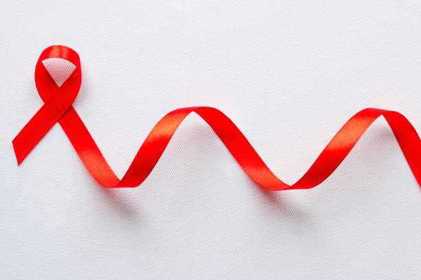 red ribbon symbol of World AIDS Day stock photo