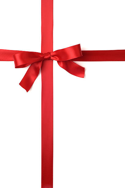 A red ribbon tied in a bow across the page stock photo