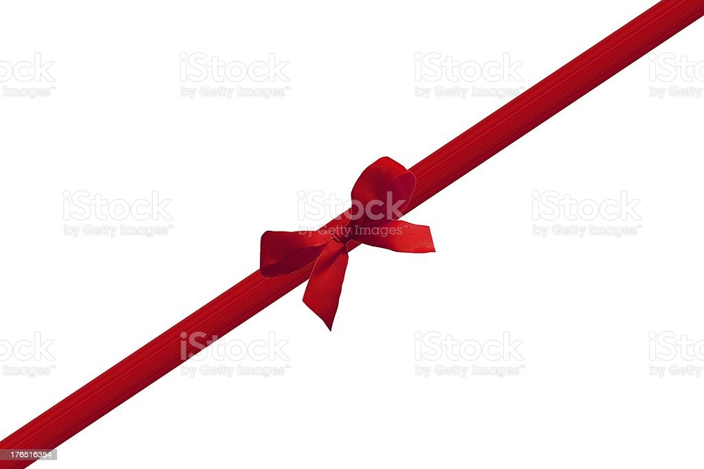 Red ribbon tied into a bow on white background stock photo