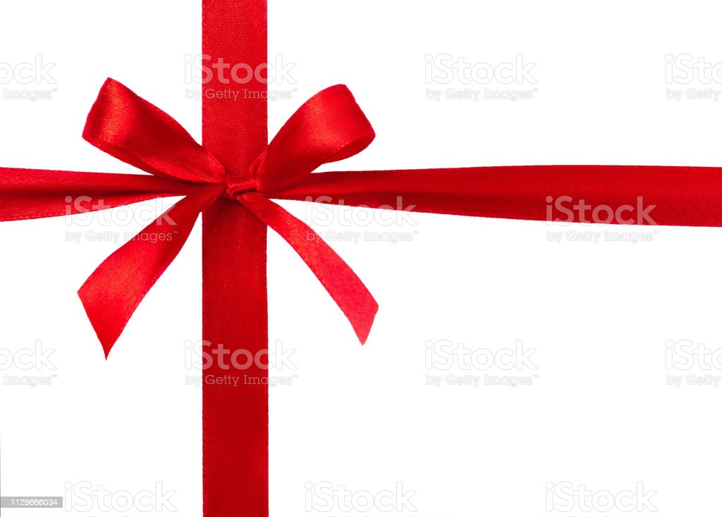 Red ribbon with bow isolated on white background. stock photo
