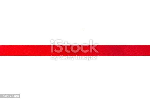 istock Red ribbon with bow isolated on white background. 842773480