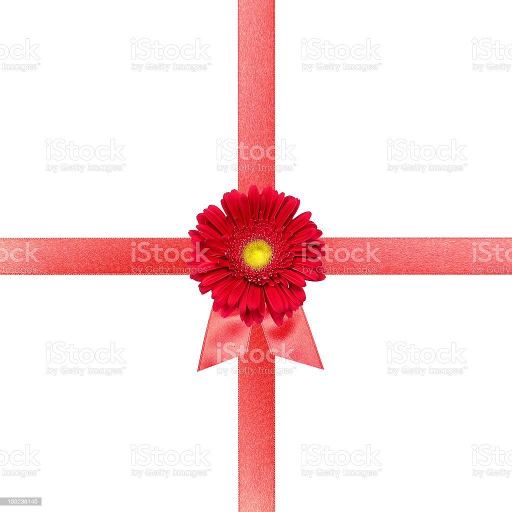 Red ribbon with flower on white card stock photo