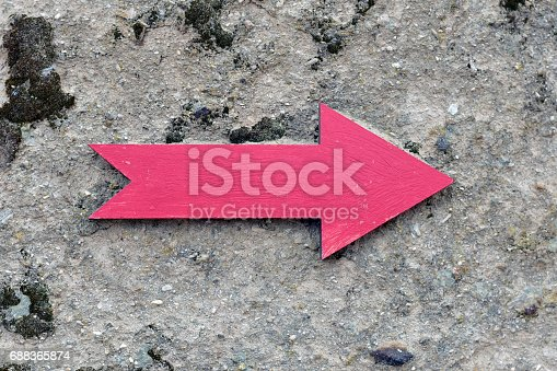 istock Red Right Direction Sign on a Rock 688365874