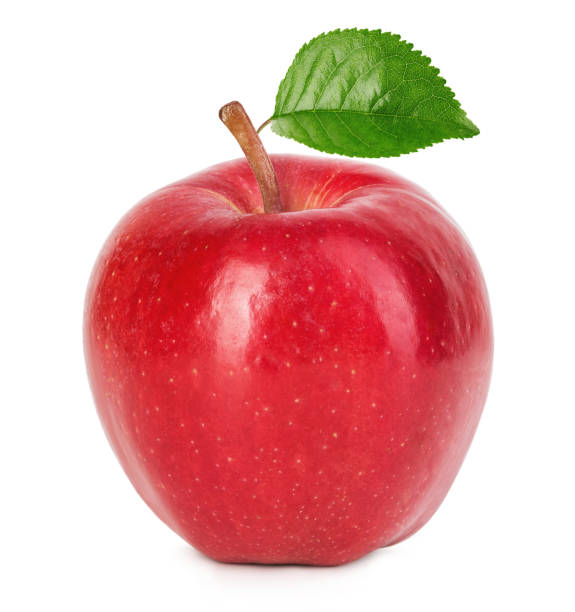 Red ripe apple with green leaf isolated on a white background. stock photo