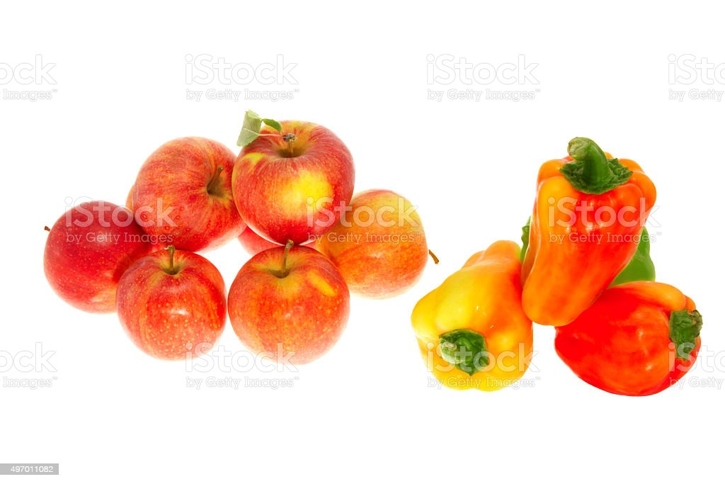 Red ripe apples and sweet pepper on a white background stock photo