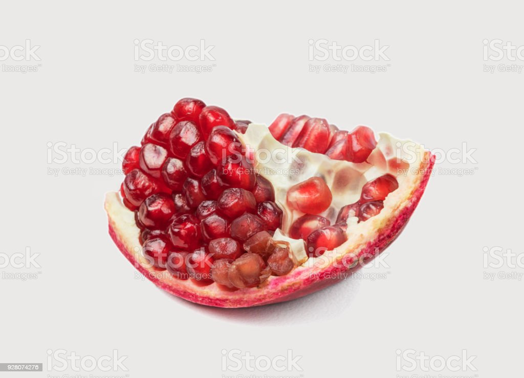 Red ripe pomegranate on a white background stock photo