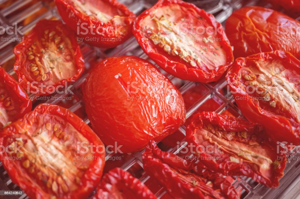 Red ripe tomatoes half prepared for drying. Selective focus. Close-up. Out of focus royalty-free stock photo